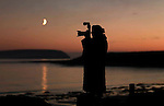 A lady photographer captures the sunset in Ireland..Picture by Don MacMonagle