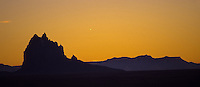"Shiprock Pinnacle, or ""Tse Bit 'Ai"", near Shiprock, New Mexico at sunset."