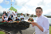 14-8-2014: repro   photo: A FEAST OF CULINARY ATHLETICS TO KICK OF IRELAND&rsquo;S FOODIEST FESTIVAL<br /> Student chef, Liadan Sheehy in front with chefs and local producers from Dingle pictured at the launch od the Dingle Food Festival which will take palce from October 3rd-5th. Included in photo are from left, Jerry Kennedy, butcher, Jim Mccarthy, restauranteur, Niall O'Conchuir, chef, and vegatable grower Derek O'Connor. At back, Clevlio Romirea, fisherman, chefs Mark Murphy, Jean marie Vaireaux, Martin Bealin, Jill Burton, Milkman Timmy Brick and  and bee keeper, Thomas Kavanagh.<br /> <br /> press release:<br /> Having been voted the No.1 Foodiest Town in Ireland earlier this year, Dingle will kick off its hugely popular Dingle Peninsula Food Festival, 3- 5 October, with a feast of culinary athletics, leaving visitors in no doubt as to why the town won this much coveted title.<br /> <br /> The inaugural Dingle Culinary Pentathlon, which will take place on the first day of the Festival, will see students from professional culinary schools throughout the country test their athletic and cookery skills to the limit. To win, students will have to race through the town, on foot and by bike, picking up a blind basket of ingredients en route.  They will then have to create a 2 course lunch in a heated cook off that will be judged by peers and top professionals alike.   <br /> <br /> To celebrate the festival&rsquo;s 8th anniversary, The Taste Trail, one of the most popular ingredients of the weekend, will now take in 80 establishments around the town; Derry Clarke, who has created the ultimate Dingle Pie, will be raising funds for charity on the Trail at Liam O&rsquo;Neill&rsquo;s art gallery, while milliner, Kathleen McAuliffe will be serving up Mad Hatter cocktails with Dingle Gin and jazz.    demos and workshops include a mix of local and national chefs such as Martin Bealin of Dingle&rsquo;s Global Village, which won Best Emerging Irish Cuisine at the RAI awards and Nevin McGuire, voted the Best Chef in Ireland, who will make his