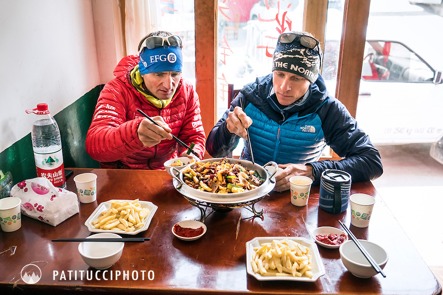 Ueli Steck and David Göttler eating in a Tibetan restaurant while on the way to their climbing expedition to the 8000 meter peak Shishapangma, Tibet
