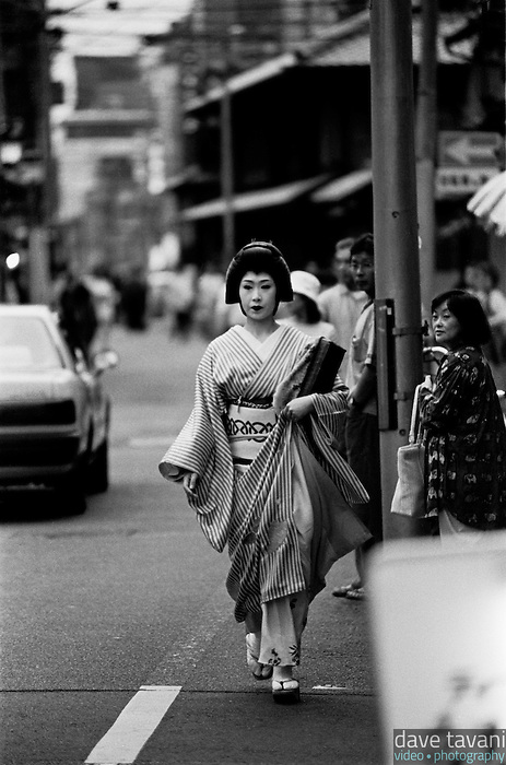 A geisha walks down a street in Kyoto, Japan's world famous geisha district, Gion Corner, May 15, 1999.