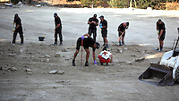 Pictured: Forensics officers assisted by Red Cross volunteers work at the farmhouse site where Ben Needham disappeared from in Kos, Greece. Tuesday 11 October 2016<br />