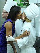 Washington, DC - February 22, 2009 -- First Lady Michelle Obama greets a chef during the Governors' dinner preview in the White House kitchen in Washington on Sunday, February 22, 2009..Credit: Kevin Dietsch - Pool via CNP