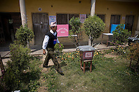 A man walking threw a pollingstation in Kathmandu. April 10th 2008 the historic Consistuent assembly elections took place in Nepal, putting an end to a centuries of monarchy. The assembly will form a new constitution and abolish the monarchy and King Gyanendras rule. The big question remains if the new maoist led government will be a positive or a negative factor in a country that recently emerged from a decade of civilwar. Photo: Christopher Olssøn.