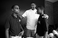 Jalen Rose talks with students Shamon Newsome and Johnny Russell from the Jalen Rose Leadership Academy charter school during the 5th annual Jalen Rose Leadership Academy golf tournament at the Detroit Golf Club in Detroit, Michigan on Monday August 31, 2015. (Photo by Jared Wickerham/The Players Tribune)