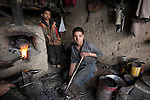 Fourteen year old Feroz Nikhad working in his uncle's foundry in Kabul. He toils for hours in the morning before school and again at the end of the day. The meagre income he produces supplements his fathers wage in supporting his six brothers and sisters. Street life in the Afghan capital of Kabul is full of interesting faces whose experience is often etched deep into the eyes. The exception being the women , whose eyes a casual observer rarely sees. Despite the ongoing struggle between radical Islamists and the moderate sections of Afghan society - and of course the coalition forces- the hospitality and vibrance of the locals is exhuberant. It has been centuries of struggle for these people and nothing, it seems , can break their spirit.