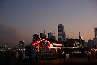 A tourist gets some information at the Skyline Cruise booth on Navy Pier under the lights in Chicago, Illinois on August 5, 2008.