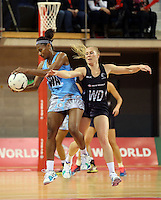 16.07.2015 Silver Ferns Laura Langman and Fiji's Maria Lutua in action during the Silver Fern v Fiji netball test match played at Te Rauparaha Arena in Porirua. Mandatory Photo Credit ©Michael Bradley.