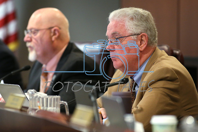 Nevada Assembly Speaker John Hambrick, R-Las Vegas, works in committee at the Legislative Building in Carson City, Nev., on Wednesday, April 22, 2015. <br /> Photo by Cathleen Allison