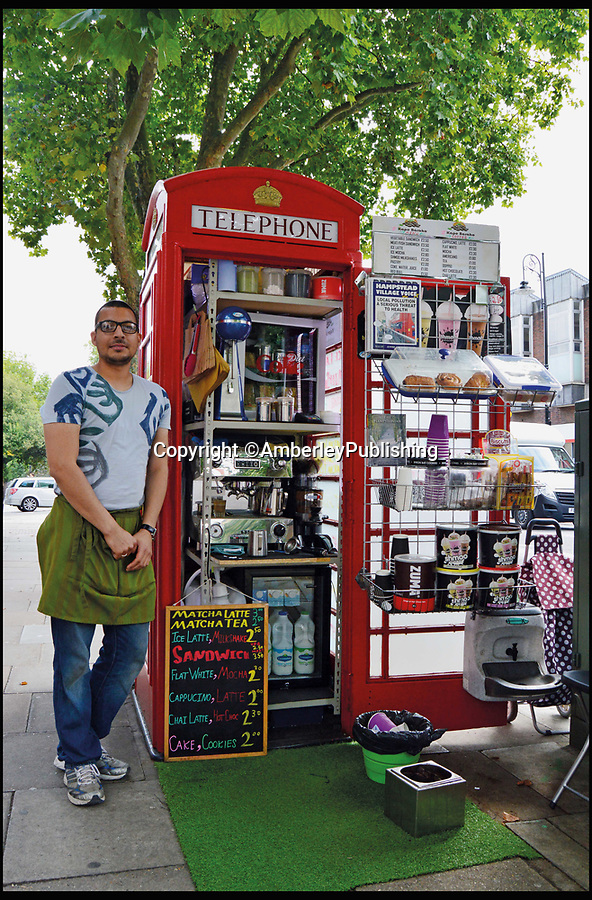 BNPS.co.uk (01202 558833)<br /> Pic: AmberleyPublishing/BNPS<br /> <br /> Umar Khalid, stood next to his Kape Barako coffee shop, opened in a K6 kiosk in Hampstead Village, North London.<br /> <br /> The iconic British phonebox has been given a ringing endorsement in a new book charting the expiring institution's fascinating history. <br /> <br /> Aptly titled 'The British Phonebox', the book primarily focuses on the ubiquitous design that's as emblematic to Britain as the black cab, double decker bus and Houses of Parliament. <br /> <br /> Equally interesting are the early chapters, which detail the phonebox's humble 19th century beginnings and the final ones, that bemoan their dwindling numbers <br /> <br /> The 96 page paperback, jointly authored by friends Nigel Linge and Andy Sutton, is published by Amberley and costs £13.49.