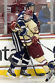 Eric Knodel (UNH - 5), Paul Carey (BC - 22) - The Boston College Eagles defeated the visiting University of New Hampshire Wildcats 4-3 on Friday, January 27, 2012, in the first game of a back-to-back home and home at Kelley Rink/Conte Forum in Chestnut Hill, Massachusetts.
