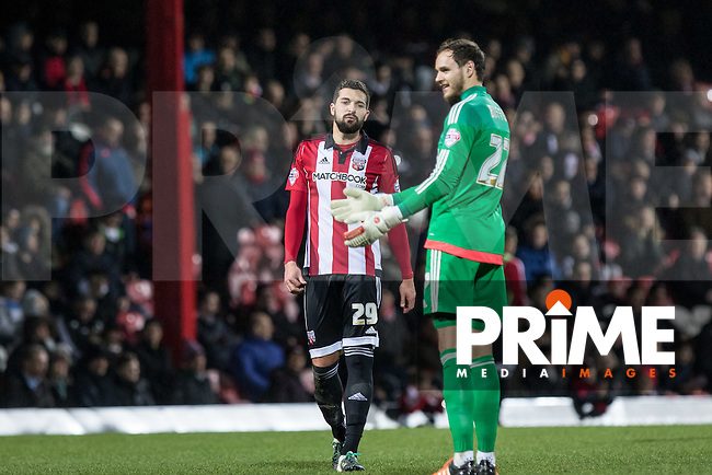 Yoann Barbet of Brentford talks to Goalkeeper David Button of Brentford during a break in play during the Sky Bet Championship match between Brentford and Leeds United at Griffin Park, London, England on 26 January 2016. Photo by Andy Rowland / PRiME Media Images.