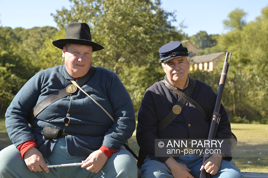 Old Bethpage, New York, U.S. 29th September 2013.  ROBERT WALKER, of Coram, and NEIL YANK, of Levittown, are portraying Civil War privates in the Union army at The Long Island Fair. A yearly event since 1842, the county fair is now held at a reconstructed fairground at Old Bethpage Village Restoration.