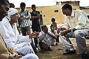 The King of Rampura, Raja Keshwendra Singh (right) speaks with his subjects while campaigning for his favoured party member in Village Hanumantpura, Dist - Jalaun, in Bundelkhand area of Uttar Pradesh, India. Feudal system still exists here in Bundelkhand and Raja Keshwendra Singh enjoys the stature of a King in this modern day and age.