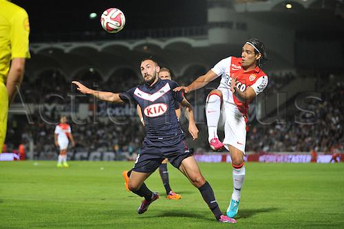 17.08.2014. Bordeaux, France. French League 1 football. Bordeaux versus Monaco.  DIEGO CONTENTO wins the challenge with RADAMEL FALCAO
