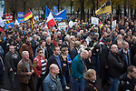 Crowds marching through the streets of Berlin during a demonstration by the Alternative für Deutschland (AfD) political party. Around 5000 supporters of the AfD took part in the march and rally calling on German Chancellor Angela Merkel to halt the influx of refugees into the country. Around one million refugees from the Middle East and north Africa arrived in Germany during 2015, 50,000 of whom came to Berlin.