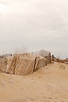 February 26, 2013. Nag's Head, North Carolina. Sand fences, which are supposed to help rebuild storm blocking dunes, have been erected all along the Outer Banks shoreline.. Tracing the path of Hurricane Sandy, which wrecked havoc on the northeastern seaboard from October 25-31, 2012. The storm caused flooding and caused an estimated 60 billion dollars worth of damage to affected areas.