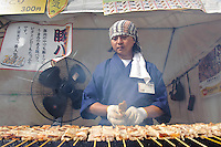 "A pork kebab stall, B1 Grand Prix, Yokote, Akita Pref, Japan, September 19 2009. The B1 Grand Prix is a competition for inexpensive and tasty regional dishes from around Japan. The B stands for ""b-class gourmet"". In 2009 it was held in the northern Japan city of Yokote."