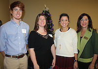NWA Democrat-Gazette/CARIN SCHOPPMEYER Susan Todd, Bentvonille Garden Club member (from left) visits with Madolyn Wynn, Jordan Slater and Kenneth, club scholarships recipients.