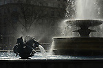 Dramatic high contrast backlit silhouette of fountain in Trafalgar Square London
