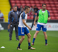 Jamie Vardy of Leicester City during the warm up as Leicester City manager Craig Shakespeare watches on during the Carabao Cup match between Sheffield United and Leicester City at Bramall Lane, Sheffield, England on 22 August 2017. Photo by James Williamson / PRiME Media Images.
