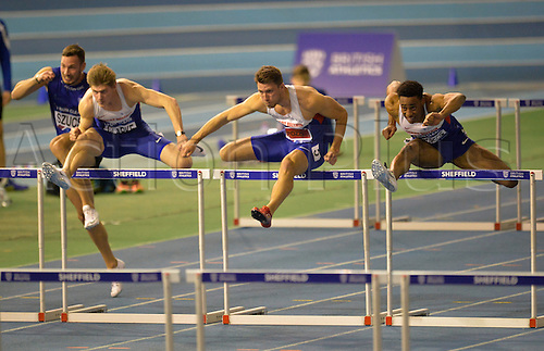 27.02.2016. EIS Sheffield, Sheffield, England. British Indoor Athletics Championships Day One. Lawrence Clark (left), Andrew Pozzi and David Omoregie (right) compete in the 60m hurdles final.