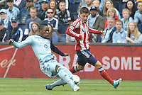 Mechack Jerome (24) defender Sporting KC tackles Jorge Villafana (19) midfield Chivas USA ..Sporting Kansas City defeated Chivas USA 4-0 at Sporting Park, Kansas City, Kansas.