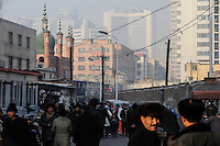 CHINA province Xinjiang city Urumqi , due to high migration of Han chinese the muslim uyghur people are a minority today, the old uyghur town is nearly demolished and replaced by new building towers, small mosque / CHINA Provinz Xinjiang , Stadt Ueruemqi , in Urumqi lebt das muslimische Turkvolk der Uiguren, durch massive Zuwanderung von Han Chinesen nur noch eine Minderheit