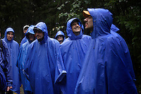 Tourists from cruise ships docking in Juneau sign up for different day trips.  This group of men hiked through the forest to see the Mendenhall glacier with Aurora and Jamie, guides with Gastineau Tours.  It was a wet walk for the blue hooded tourists who tried to keep having a good time in the pouring rain with few views through the fog. Sometimes 5 or 6 cruise ships dock during the day increasing the city's population by 12,000 people.  They buy jewels, furs and memories of the Southeast Inside Passage. Many of the stories in the downtown are owned by the cruise ships.