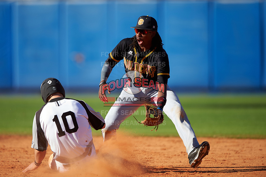 Bethune-Cookman Wildcats shortstop Demetrius Sims (7) waits for a throw as Daulton Varsho (10) slides into second base during a game against the Wisconsin-Milwaukee Panthers on February 26, 2016 at Chain of Lakes Stadium in Winter Haven, Florida.  Wisconsin-Milwaukee defeated Bethune-Cookman 11-0.  (Mike Janes/Four Seam Images)