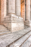 Corinthian columns flank the doors at the main entrance to the New York Public Library's Stephen A. Schwarzman Building at the top of stairs leading from 42nd Street in New York City.