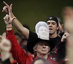 A fan with a photo of fired Texas Tech coach Mike Leach in his hat salutes during the second half of the Valero Alamo Bowl, Saturday, Jan. 2, 2010, at the Alamodome in San Antonio. Texas Tech won 41-31. (Darren Abate/pressphotointl.com)