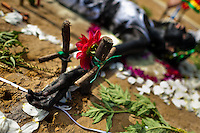 Diana R., who claims to be possessed by spirits, lies on the ground surrounded by crosses and flowers during a ritual of exorcism performed by Hermes Cifuentes in La Cumbre, Colombia, 28 May 2012. Exorcism is an ancient religious practice of evicting spirits, generally called demons or evil. Although the formal catholic rite of exorcism is rarely seen and must be only conducted by a designated priest, there are many pastors and preachers in Latin America performing exorcism ceremonies. The 52-year-old Brother Hermes, as the exorcist calls himself, claims to have been carrying out the healing rituals for more than 20 years. Using fire, dirt, candles, flowers, eggs and other natural-based items, in conjunction with Christian religous formulas, he attempts to drive the supposed evil spirit out of a victim's mind and body.