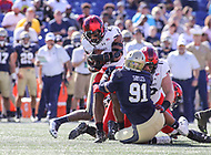 Annapolis, MD - September 23, 2017: Navy Midshipmen defensive end Tyler Sayles (91) tackles Cincinnati Bearcats running back Gerrid Doaks (23) during the game between Cincinnati and Navy at  Navy-Marine Corps Memorial Stadium in Annapolis, MD.   (Photo by Elliott Brown/Media Images International)