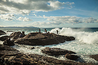 December 19, 2011 - Laxe (La Coruña). A group of percebeiros escape from an unexpected wave. Even when the weather is good, the sea is extremely dangerous in this part of the coast. © Thomas Cristofoletti 2011