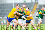 Kerry Stephen O'Brien is tackled by Roscommon's Niall McInerney and David Murray during their NFKL Div 1 clash in Fitzgerald Stadium on Sunday