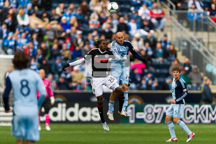 Keon Daniel (26) of the Philadelphia Union and Aurelien Collin (78) of Sporting Kansas City go up for a header during a Major League Soccer (MLS) match at PPL Park in Chester, PA, on March 2, 2013.