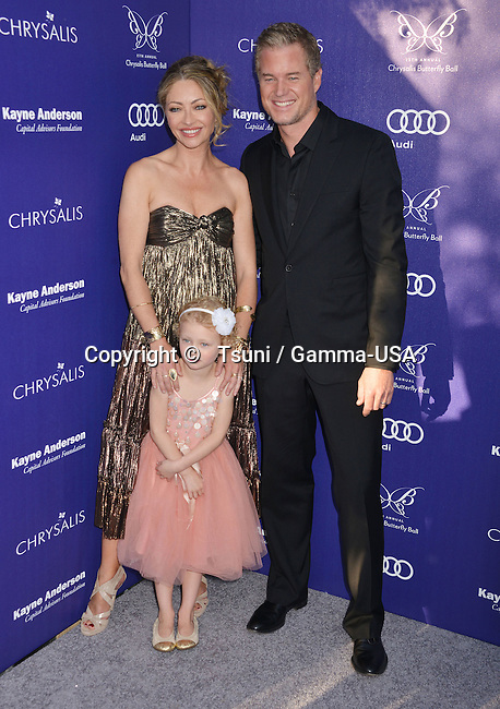 Rebecca Gayheart-Dane, Eric Dane, and daughter Billie Beatrice at the 13th Chrysalis Butterfly Ball in Brentwood Private Mandeville Canyon state in Los Angeles.