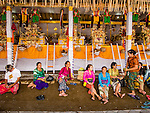 14 JULY 2016 - UBUD, BALI, INDONESIA: Women relax in front of the alters of their family members who will be cremated in a mass cremation Saturday. Local people in Ubud exhumed the remains of family members and burned their remains in a mass cremation ceremony Wednesday. Thursday was spent preparing for Saturday's ceremony that concludes the cremation. Almost 100 people will be cremated and laid to rest in the largest mass cremation in Bali in years this week. Most of the people on Bali are Hindus. Traditional cremations in Bali are very expensive, so communities usually hold one mass cremation approximately every five years. The cremation in Ubud will conclude Saturday, with a large community ceremony.     PHOTO BY JACK KURTZ