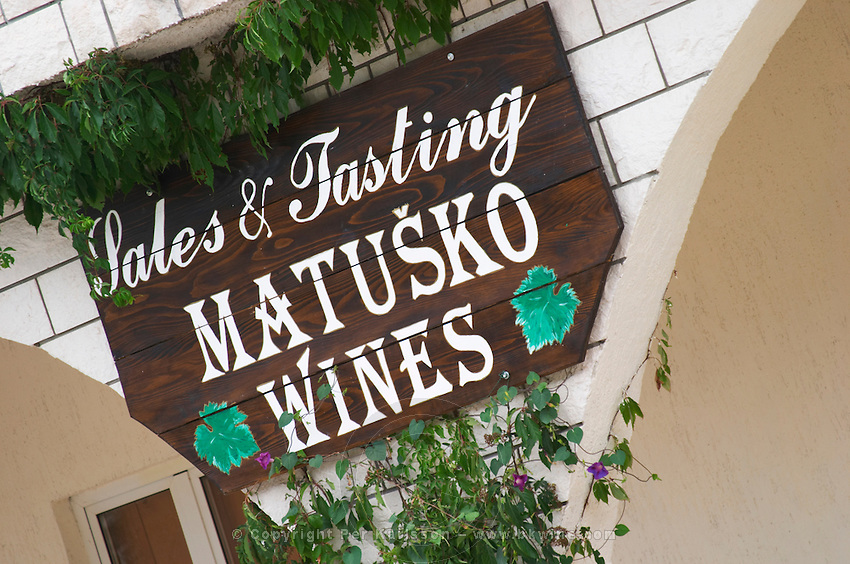 Entrance to the winery with sign Sales and Tasting. Matusko Winery. Potmje village, Dingac wine region, Peljesac peninsula. Matusko Winery. Dingac village and region. Peljesac peninsula. Dalmatian Coast, Croatia, Europe.