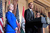 United States President Barack Obama, center, makes remarks as U.S. Secretary of State Hillary Rodham Clinton, left, and Foreign Minister S.M. Krishna of India, right look on at a reception in the Minister's honor at the State Department  in Washington, D.C. on Thursday, June 3, 2010..Credit: Ron Sachs - Pool via CNP