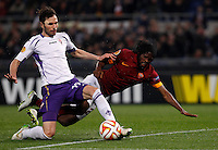 Calcio, Europa League: Ritorno degli ottavi di finale Roma vs Fiorentina. Roma, stadio Olimpico, 19 marzo 2015.<br /> Fiorentina's Jose' Basanta, left, is challenged by Roma's Gervinho during the Europa League round of 16 second leg football match between Roma and Fiorentina at Rome's Olympic stadium, 19 March 2015.<br /> UPDATE IMAGES PRESS/Isabella Bonotto