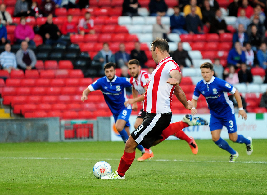 Lincoln City's Matt Rhead scores his sides fourth goal <br /> <br /> Photographer Andrew Vaughan/CameraSport<br /> <br /> Football - Vanarama National League - Lincoln City v North Ferriby United - Tuesday 9th August 2016 - Sincil Bank - Lincoln<br /> <br /> &copy; CameraSport - 43 Linden Ave. Countesthorpe. Leicester. England. LE8 5PG - Tel: +44 (0) 116 277 4147 - admin@camerasport.com - www.camerasport.com