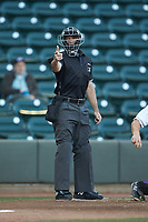 Home plate umpire Matthew Brown makes a strike call during the Carolina League game between the Salem Red Sox and the Winston-Salem Dash at BB&T Ballpark on April 20, 2018 in Winston-Salem, North Carolina.  The Red Sox defeated the Dash 10-3.  (Brian Westerholt/Four Seam Images)