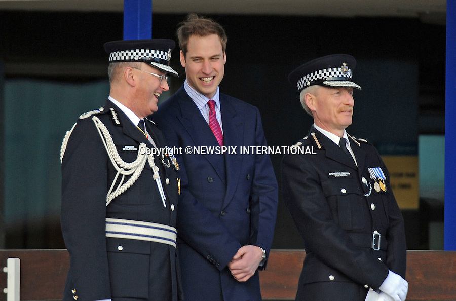 """PRINCE WILLIAM.Attend a Passing Out Parade at Hendon Police Training College..The Prince reviewed new graduation officers at their passing out parade as well as meeting a dog division, mounted horse division and a motorbike unit..William got a surprise when one of the horses sneezed on him, leaving his suit speckled with horse saliva. Hendon Police Training College, London_06/03/2009..Mandatory Credit Photo: ©DIAS-NEWSPIX INTERNATIONAL..Please telephone : +441279324672 for usage fees..**ALL FEES PAYABLE TO: """"NEWSPIX INTERNATIONAL""""**..IMMEDIATE CONFIRMATION OF USAGE REQUIRED:.Newspix International, 31 Chinnery Hill, Bishop's Stortford, ENGLAND CM23 3PS.Tel:+441279 324672  ; Fax: +441279656877.Mobile:  07775681153.e-mail: info@newspixinternational.co.uk"""