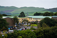 COPY BY TOM BEDFORD<br /> Pictured: Ysgol Penglais School in Aberystwyth, Wales, UK<br /> Re: More than 400 pupils at a comprehensive school in Aberystwyth were given detention on their first day back for breaking school uniform rules.<br /> The uniform was changed at Ysgol Penglais over the summer, following a consultation.<br /> But a number of parents have complained to the school and some 250 have signed a petition saying the punished pupils were &quot;treated unfairly&quot;.<br /> Ceredigion council said a large number of pupils were kept in at break times.<br /> The new uniform was brought in for the start of the new academic year, with the old navy blue pullover and white polo shirt replaced by a grey v-neck jumper, white shirt and a tie. Sixth formers have a similar outfit.<br /> It is compulsory for all pupils in years 7 and 12 to wear the new uniform, with other students being given the rest of the year to buy it.<br /> This was outlined in correspondence sent to all parents over the summer months, which also stipulated what trousers, skirts and shoes would be deemed acceptable.<br /> But the petition said the new rules were not clear enough and that the pupils should not have been punished for their parents' mistakes.<br /> It also said a warning should have been given before the detention.