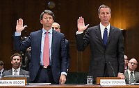 """Mark W. Begor, Chief Executive Officer, Equifax, Inc., left, and Arne M. Sorenson, President and Chief Executive Officer, Marriott International, Inc., are sworn-in to testify before the United States Senate Committee on Homeland Security and Governmental Affairs Permanent Subcommittee on Investigations during a hearing on """"Examining Private Sector Data Breaches"""" on Capitol Hill in Washington, DC on Thursday, March 7, 2019.<br /> Credit: Ron Sachs / CNP/AdMedia"""