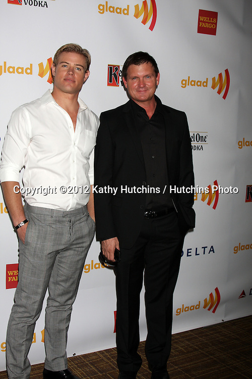 LOS ANGELES - APR 21:  Trevor Donovan, Kevin Williamson. arrives at the 23rd GLAAD Media Awards at Westin Bonaventure Hotel on April 21, 2012 in Los Angeles, CA