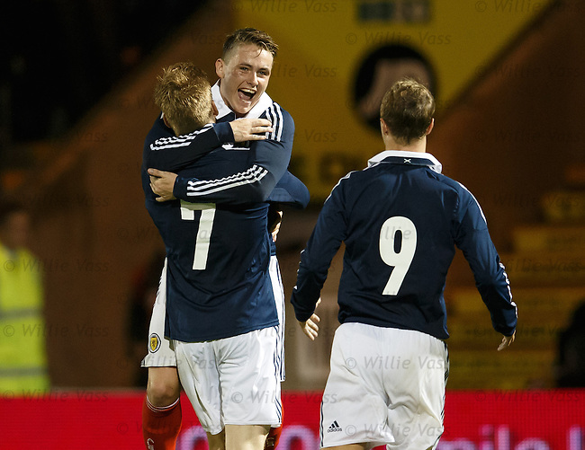 Stuart Armstrong takes the acclaim of Scott Allan and Leigh Griffiths after scoring