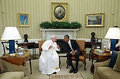 (L-R) Pope Francis and U.S. President Barack Obama talk in the Oval Office during the arrival ceremony at the White House on September 23, 2015 in Washington, DC. The Pope begins his first trip to the United States at the White House followed by a visit to St. Matthew's Cathedral, and will then hold a Mass on the grounds of the Basilica of the National Shrine of the Immaculate Conception. <br /> Credit: Alex Wong / Pool via CNP